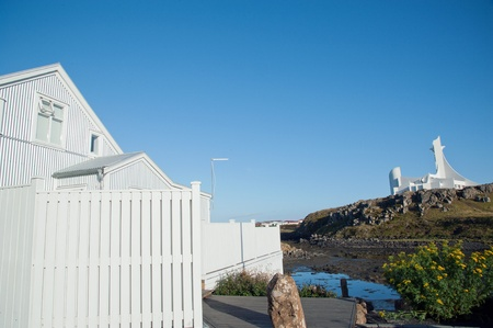 The West Island, look at the new church, in the foreground a white wooden house, in the port city Stykkisholmur, the north of Sneifellsnes