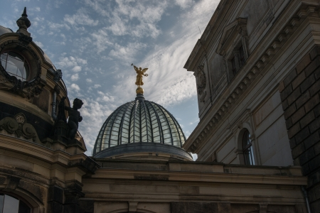 Called Dresden Art Academy, overlooking the main portal and the glass dome, also lemon squeezer stated