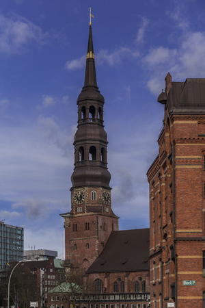 Hamburg, harbor city, in the warehouse district, church tower of St  Catherine, in the right foreground of the memory block P, as seen from the Neuerwegs bridge from Stock Photo