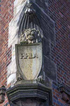 Hamburg, harbor city, in the warehouse district, stone lion with HHLA Shield