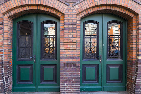 Hamburg, harbor city, in the warehouse district, courtyard, double door Stock Photo
