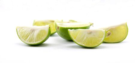 quarters: Fresh cut lime quarters  citrus fruit isolated on white background with shadow Stock Photo