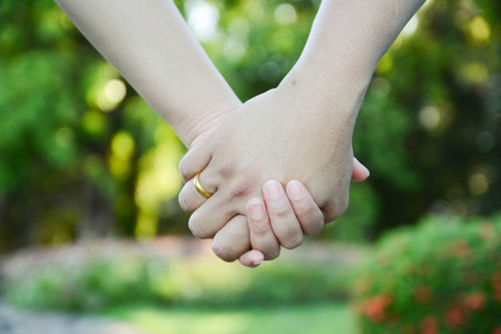 tenderly: two pairs of hands in love tenderly hold together Stock Photo