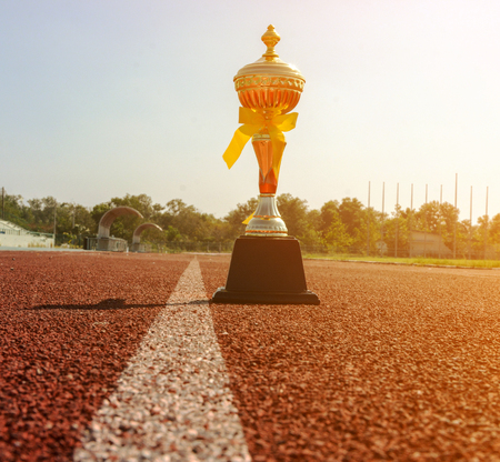 Gold One Trophy, track running, gold trophy cup Running race lane Banco de Imagens