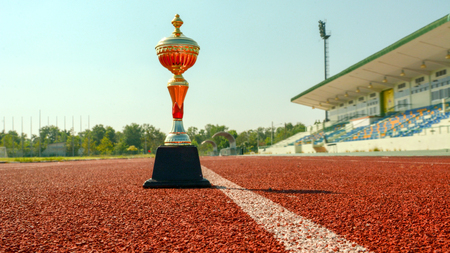 Gold One Trophy  and  track running Banco de Imagens