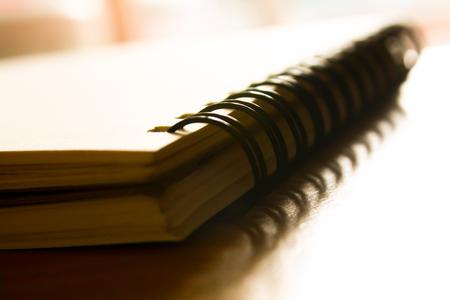 photo of notebook on wooden floor.