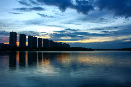 city scape at night with reflection on lake. Thailand. sunset with sky. small lake in city.