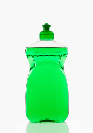 intoxication: Bottle of green bubbling dish liquid isolated on a white background