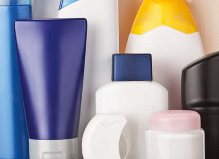 productos de aseo: Set of colorful toiletries cosmetic plastic bottles