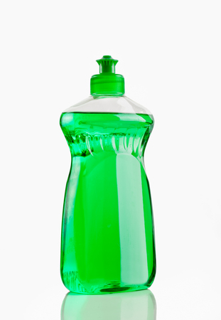 Bottle of green bubbling dish liquid isolated on a white background.