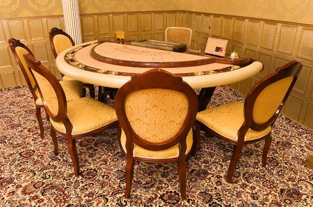 pokers: gold card-table with chairs in vip hall of casino