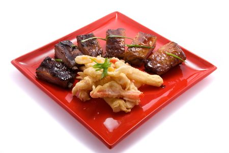 young pig: ribs of young pig on red plate