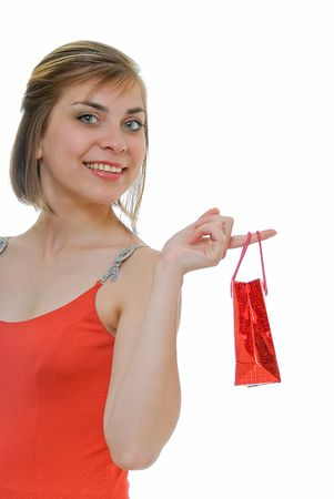 young woman in red with red gift on white photo