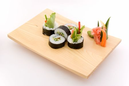 vegetarian roll on wooden plate photo