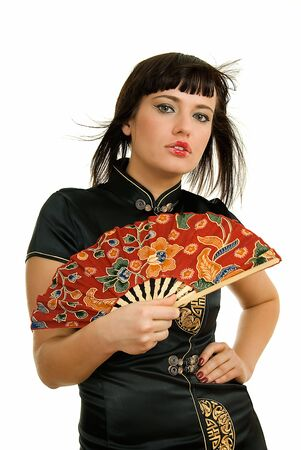 young woman with fan in japanese manner  photo