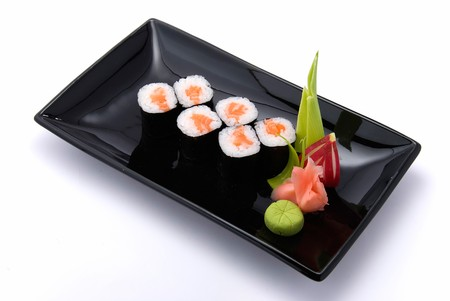 rolls on black plate with white background photo