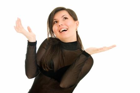 extase: jonge vrouw toont ecstasy naar iets op witte achtergrond