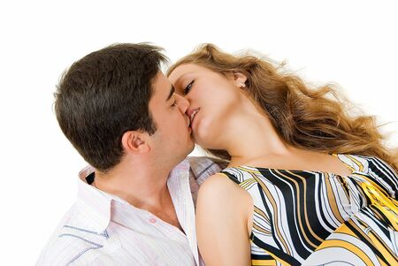 kissing young couple with open eyes on white background  photo