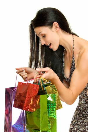 young woman scrutinizes her gift in color packets photo