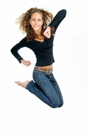 gambe aperte: salto piuttosto divertente ragazza su bianco Archivio Fotografico
