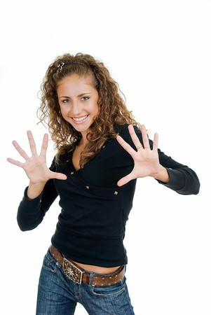adult pretty smiling girl shows ten fingers   Stock Photo