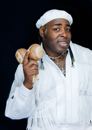 cuban black man with maracas on black background  Stock Photo - 4097039