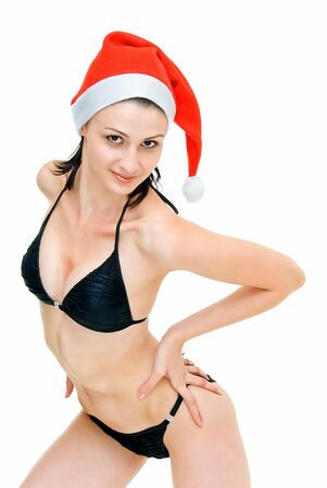 young pretty woman in swimsuit and santas cap photo