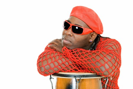 relaxing black cuban man on percussion on white background photo
