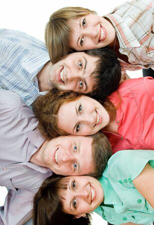 five young people lie head on head on white background Stock Photo - 4316350
