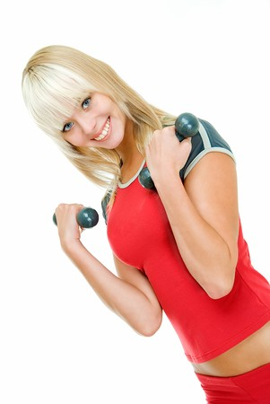 young charming girl does physical exercises with dumbbells   photo