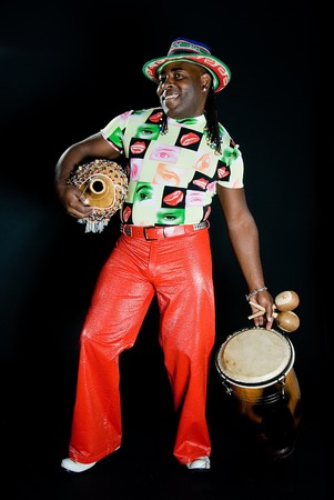 Young sympathetic cuban man with percussion on black background photo