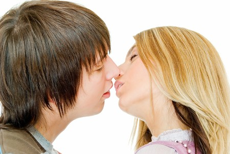 nice and young kissing couple on white background