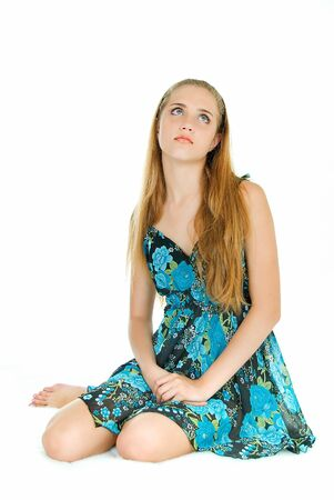 young beauty sits on white background and waits photo