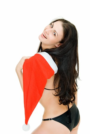 young pretty woman in swimsuit and santa  cap photo