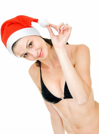 young pretty girl in swimsuit and cap of santa photo