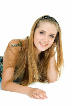 young adult pretty girl lies and smiles on white photo