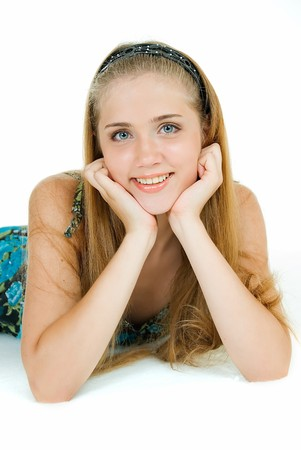young adult pretty girl lies and smiles  photo