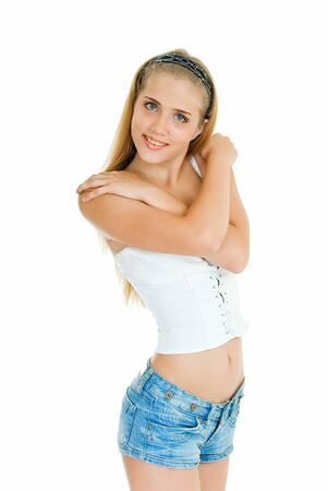 young pretty girl stands and smiles on white background  photo