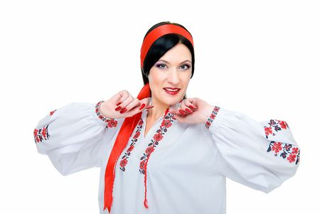 beauty woman dances, she is in traditional ukrainian clothes   photo