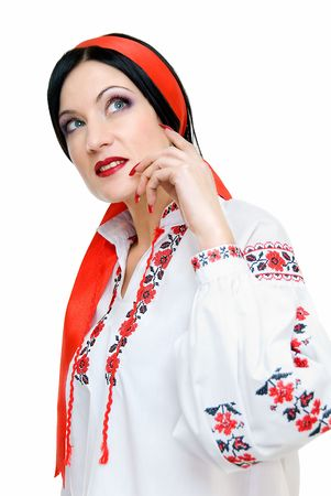 beauty woman looks darkly, she is in traditional ukrainian clothes   photo