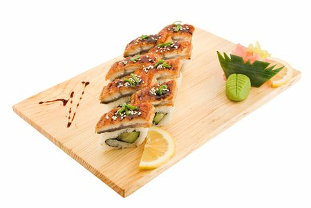 appetizing aromatic rolls on wooden plate isolated photo
