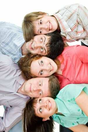 five young people lie head on head on white background and looking one on other Stock Photo