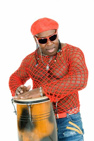 young handsome cuban man plays on percussion photo