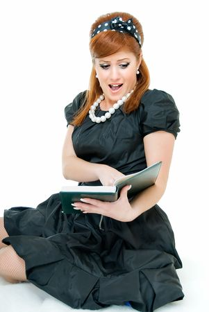 young pretty woman reads something with emotions photo