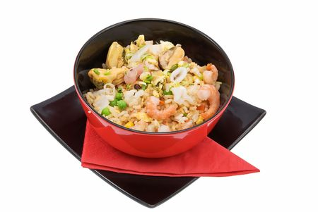 black plate with rice and seafood on white  photo