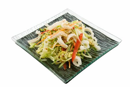 plate with salad with squids on white photo