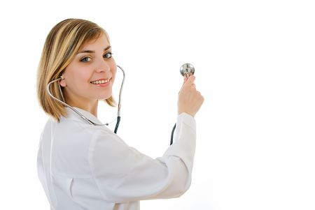 young pretty doctor checking something with stethoscope  Banco de Imagens