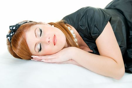 young pretty asleep girl on white background  photo
