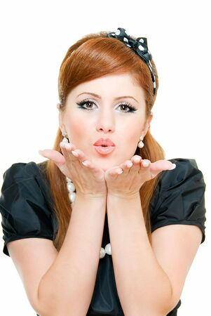 young beauty woman holds palm up and blows kisses photo
