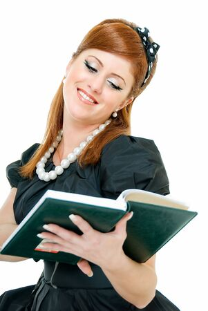 young pretty contented redheaded woman reads something photo
